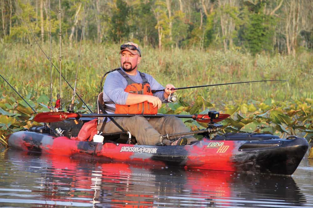 A well-equipped kayak provides John Leavitt the stealth to sneak into the cover where snakeheads lurk.  photos by David Hart