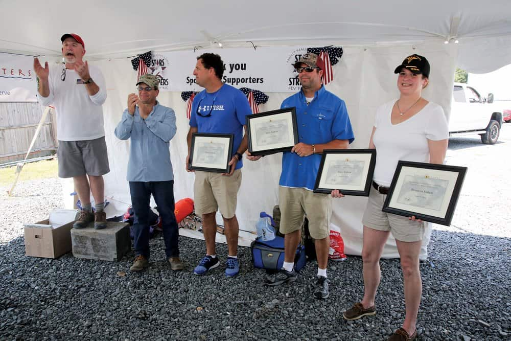 The Fulton family accepts awards for service to the program. Photo by Martin image photography.