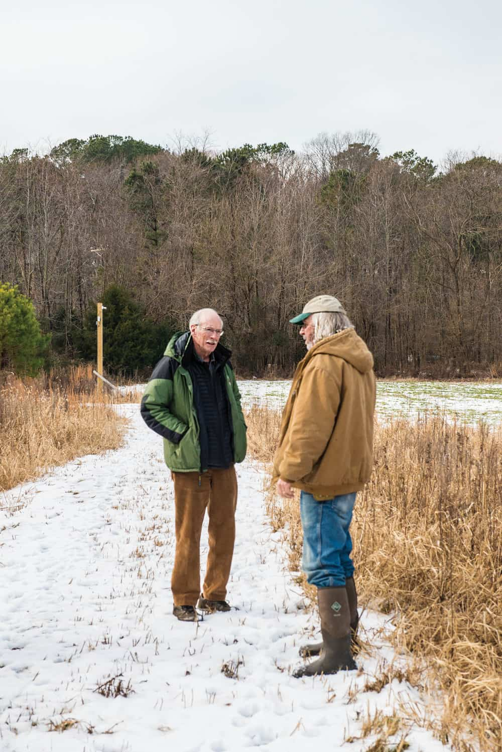 Gerber (right) talks with Stanley Watkins, a CWH board member.