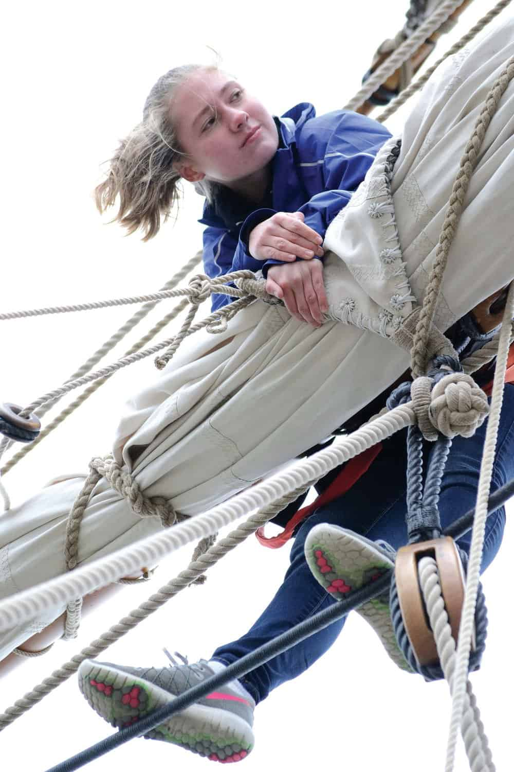 Anna Hower tends to the sails aloft.- Photos by K aren Soule