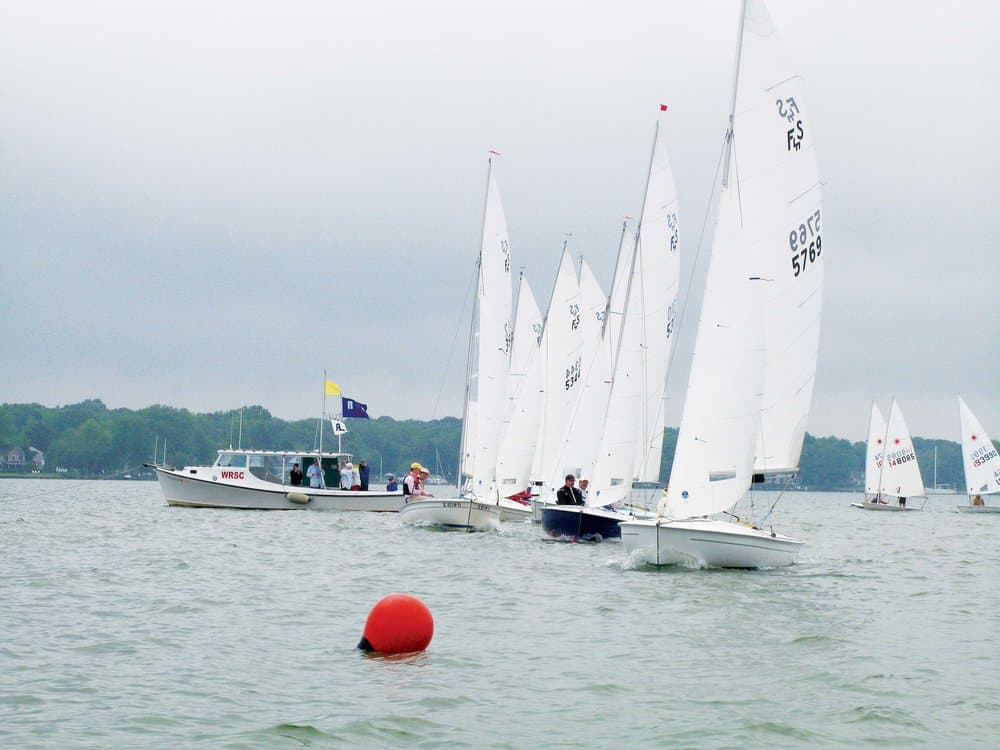 Flying Scot Fleet 97 lines up for a start in the West River Sailing Club Regatta.  photo by Reed Wickne