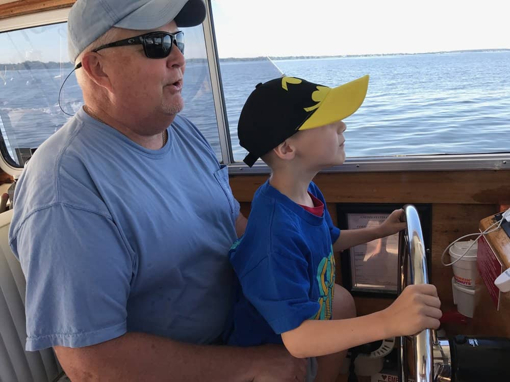 Captain Eichler and Houston at the helm.