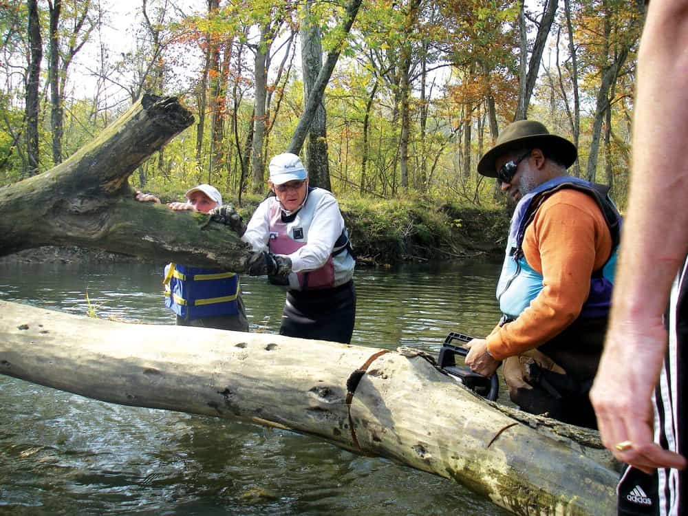 Tutman on the Patuxent with volunteers Ken Hastings and Will Wallace clearing snags.Courtesy of Fred Tutman.