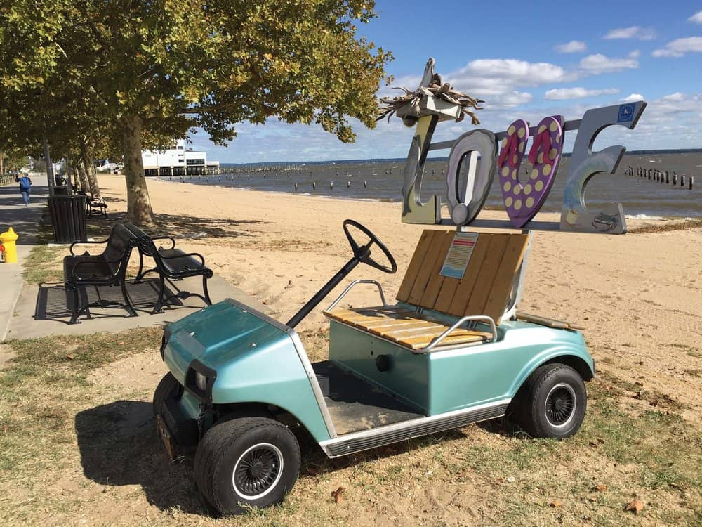 """Colonial Beach's """"LOVEwork"""" display—a tribute to Colonial Beach's golf-cart town tradition, local beach vibe, and a tourist attraction, all in one. photos by Jody Argo Schroat"""