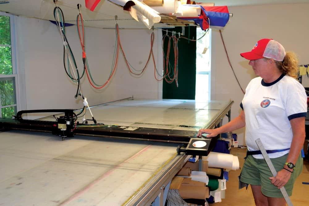 Stephanie Sweeney operates a cutting machine. Photo by Karen Soule.