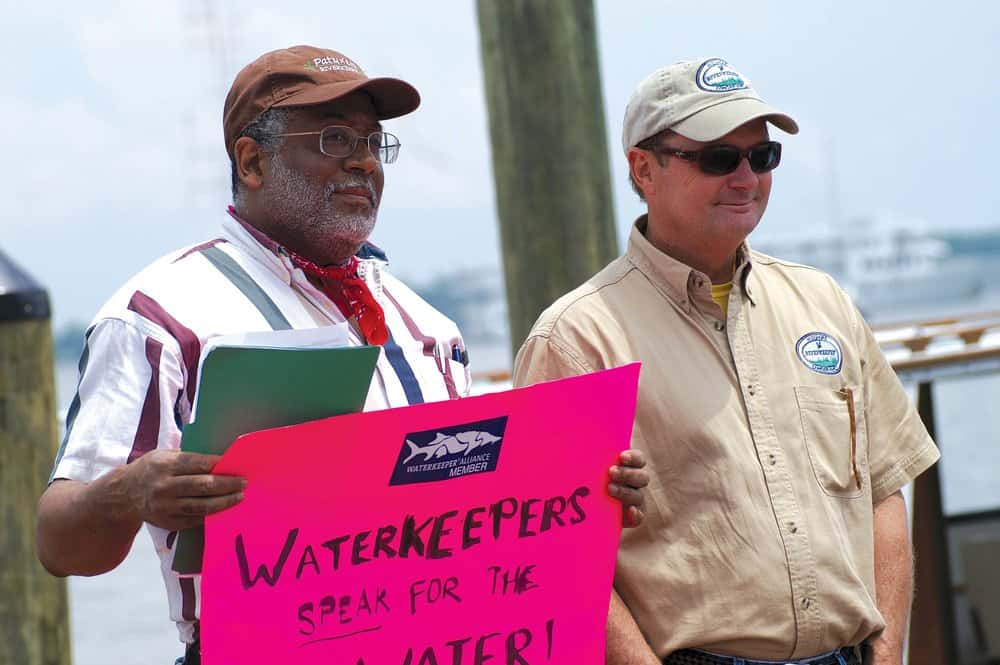 Tutman, protest sign in hand, stands with fellow riverkeepers protesting the lack of progress in at the Annapolis City Dock event is Tim Junkin, of the Midshore Riverkeeper Conservancy.Courtesy of Fred Tutman.