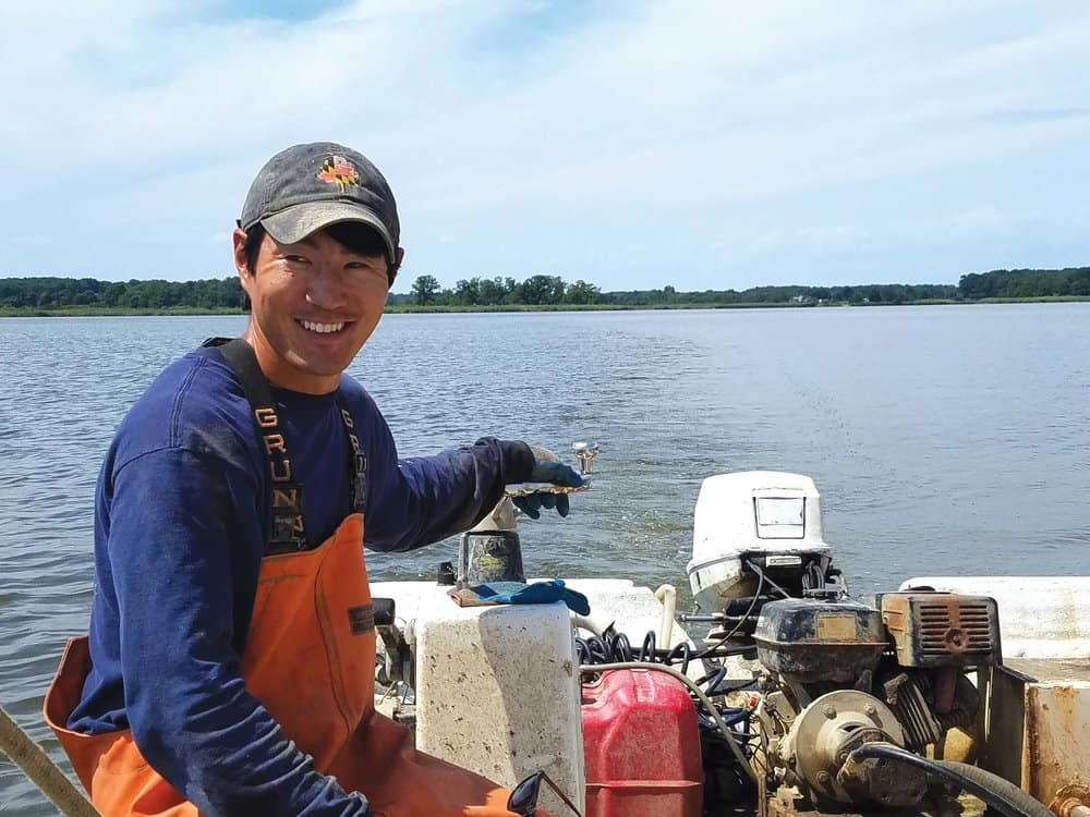 Scott Budden and mate Sean Corcoran on the Chester River, working Budden's oyster lease.Photo by Laura Boycourt.