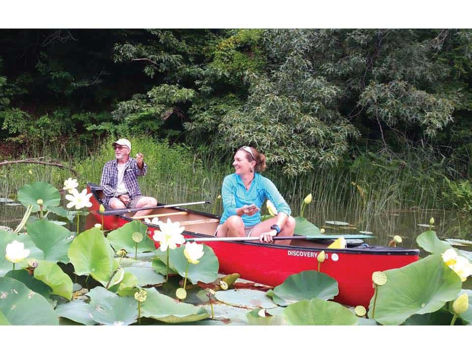 """Gilchrest during lotus season in his Turner's Creek """"classroom."""""""