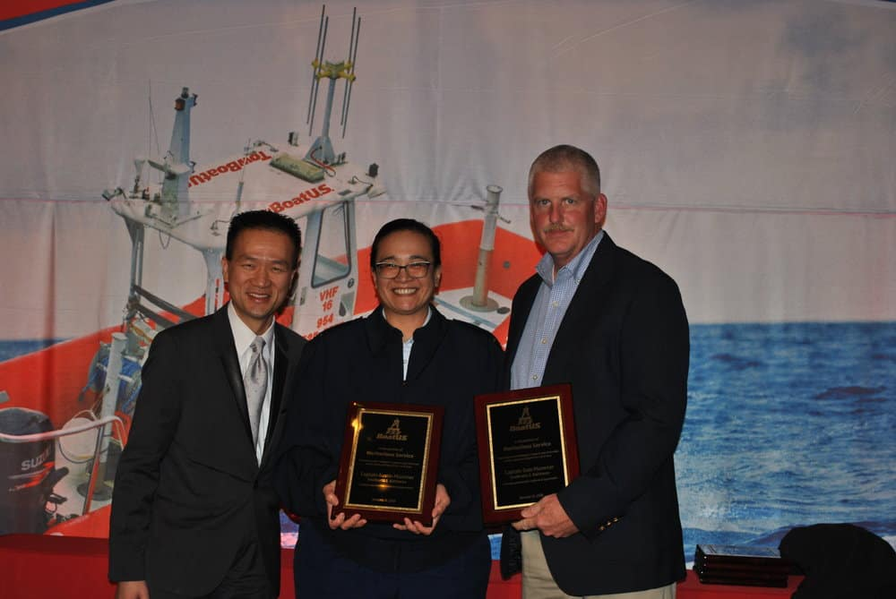 Captain Dale Plummer (right) accepts the award from BoatUS