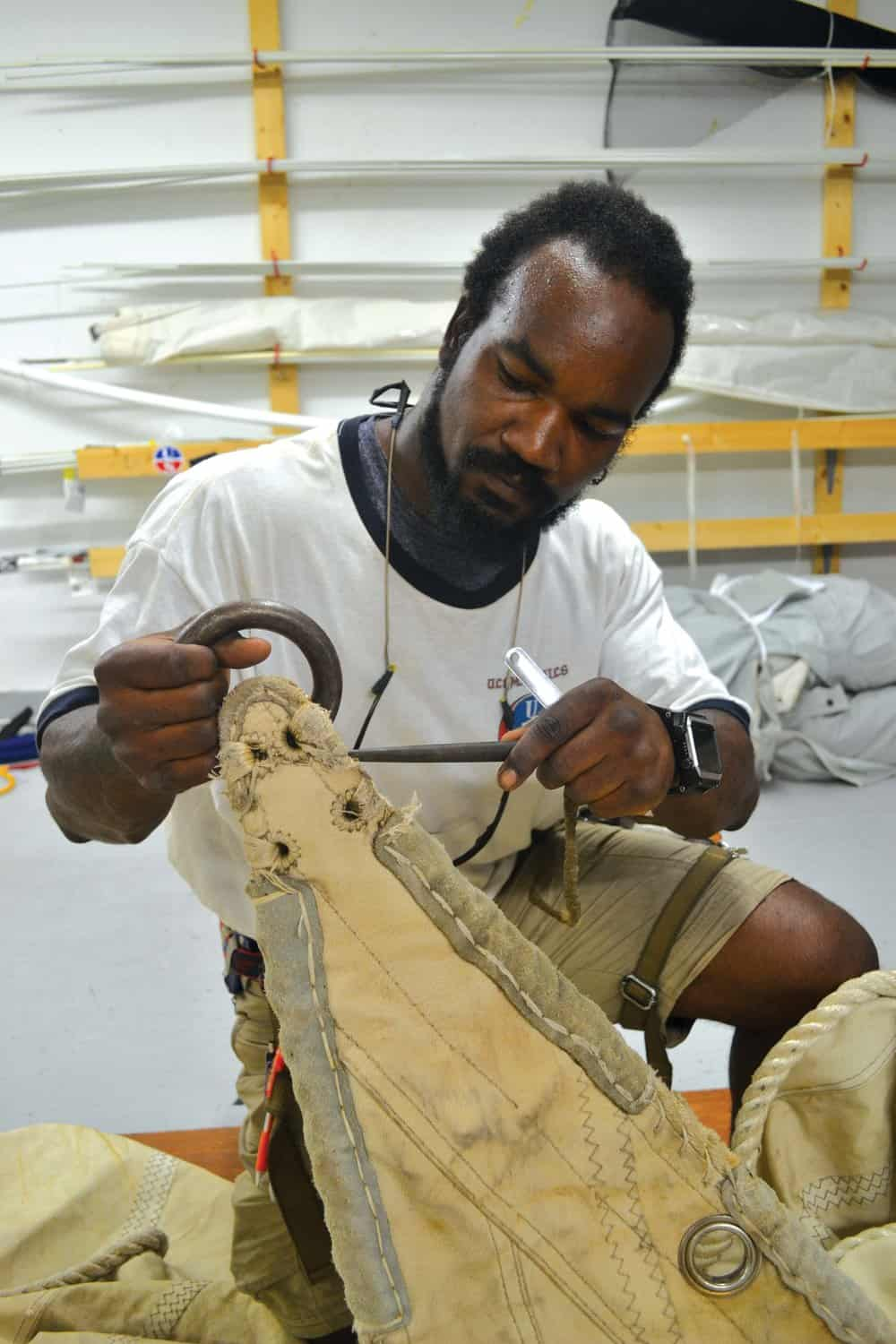 Dantes Chambre-Serres examines one of the  Eagle 's old sails.Photo by Karen Soule.