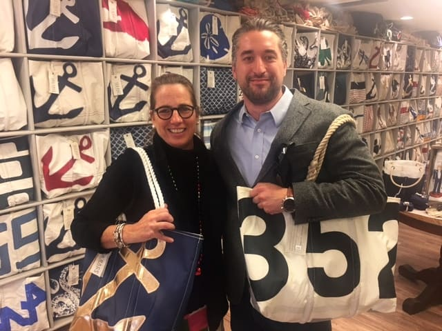 Sea Bags Director of Retail, Amy, with a happy customer