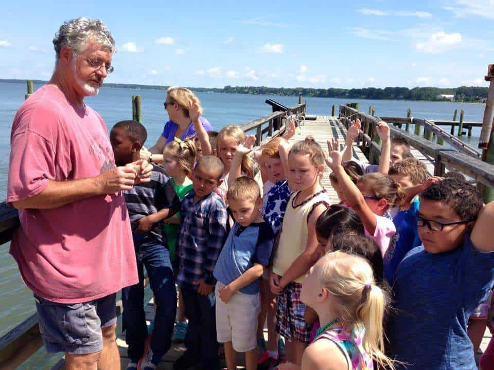 Michael Steen uses hands-on learning to teach a group of students about the environment.