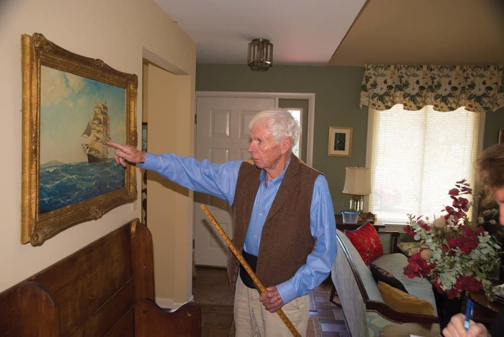 Hecklinger points out what's correct in the painting. Photo by Joe Evans.