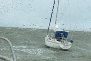 Sailor Rescued in Rough Conditions at Mouth of Bay